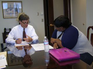 Signing the mortgage and making the commitment to homeownership.