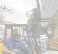 Aqua-Flo employee using fork lift to load pipe into customer's truck in Santa Clarita.