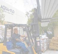 Aqua-Flo employee using fork lift to load pipe into customer's truck in Santa Clarita.