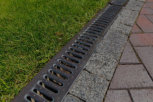 iron grate of a drainage system