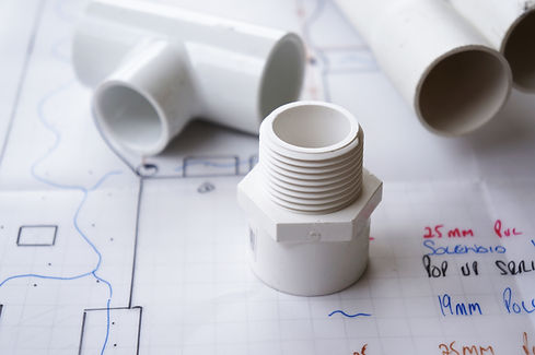 Pipe fittings on a set of landscape plans.