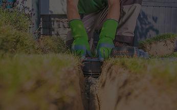 Installer installing pump in ground.
