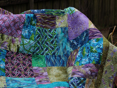 "Win this stunning, handmade ""Voices of the River"" quilt!"