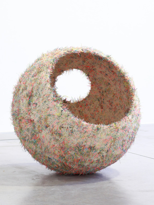 Bouy.  2018.  Water carved plaster and thread.  50cm diameter.