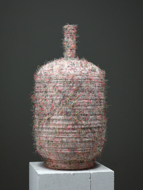 Pink Flask.  2018.  Water carved plaster and thread.  62cm tall.