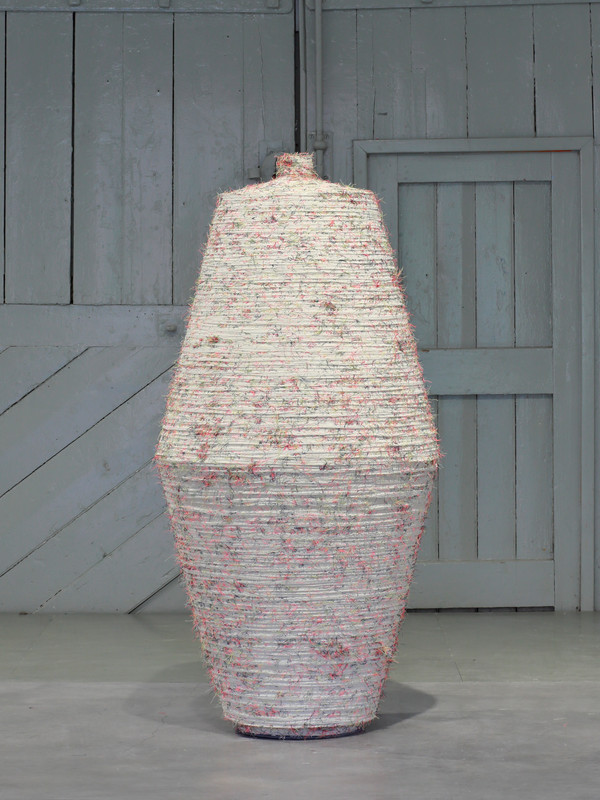 Large Flask. 2018.  Water carved plaster and thread.  134cm tall.