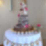 Naked wedding cake with cupcakes