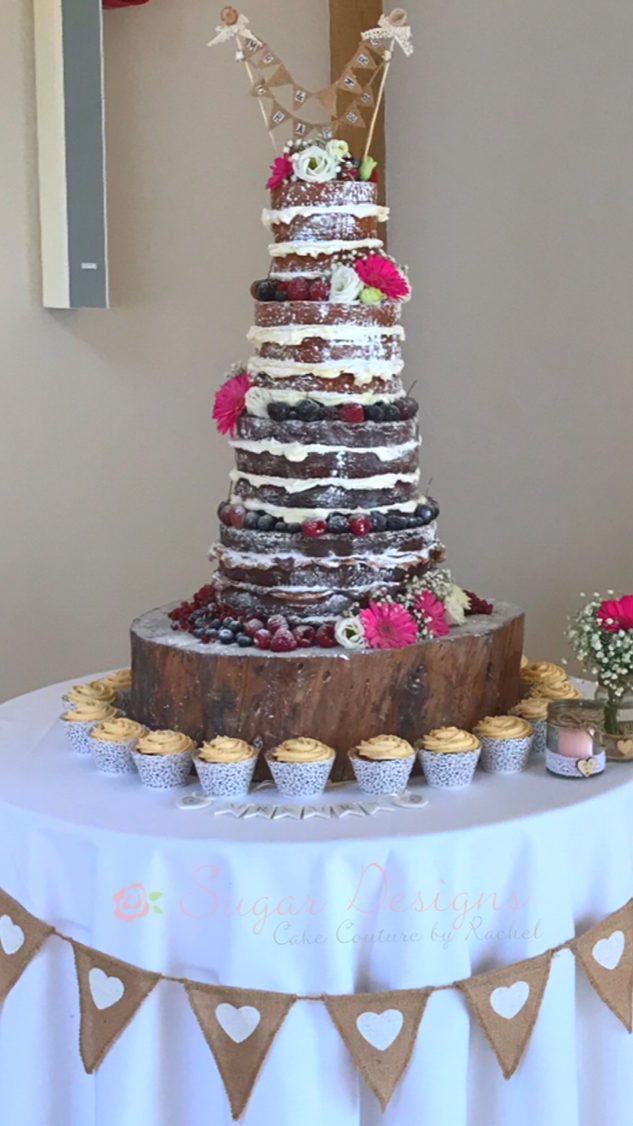 Naked wedding cake with cupcakes