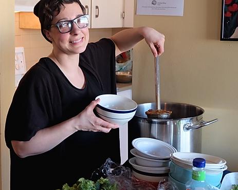 Soup kitchen volunteer in action