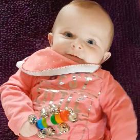 Elsie-Rose enjoying bell rattle and ribbon ring