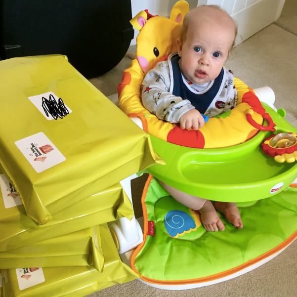 Joey helping with the first lot of orders for our baby sensory boxes