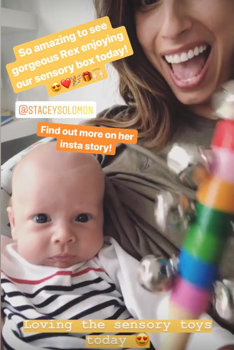 Stacey and baby Rex playing with their sensory toys