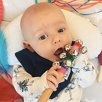 Finlay playing with bell rattle