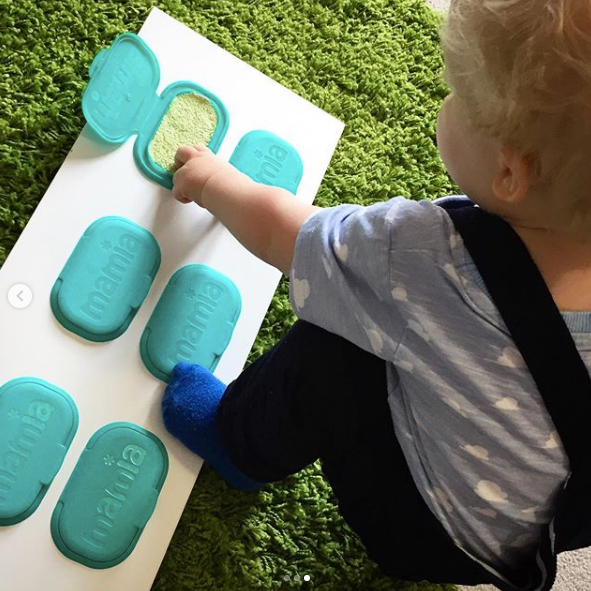 Joey playing with his sensory board