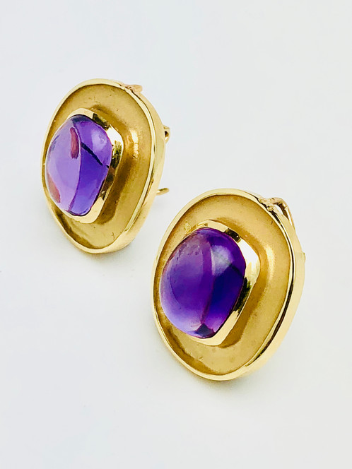 14k Yellow Gold Amethyst Earrings Feature Cabochon Stones Framed By Brush And High Polish Finishes Wire On Back Of Earring Allows For Diffe
