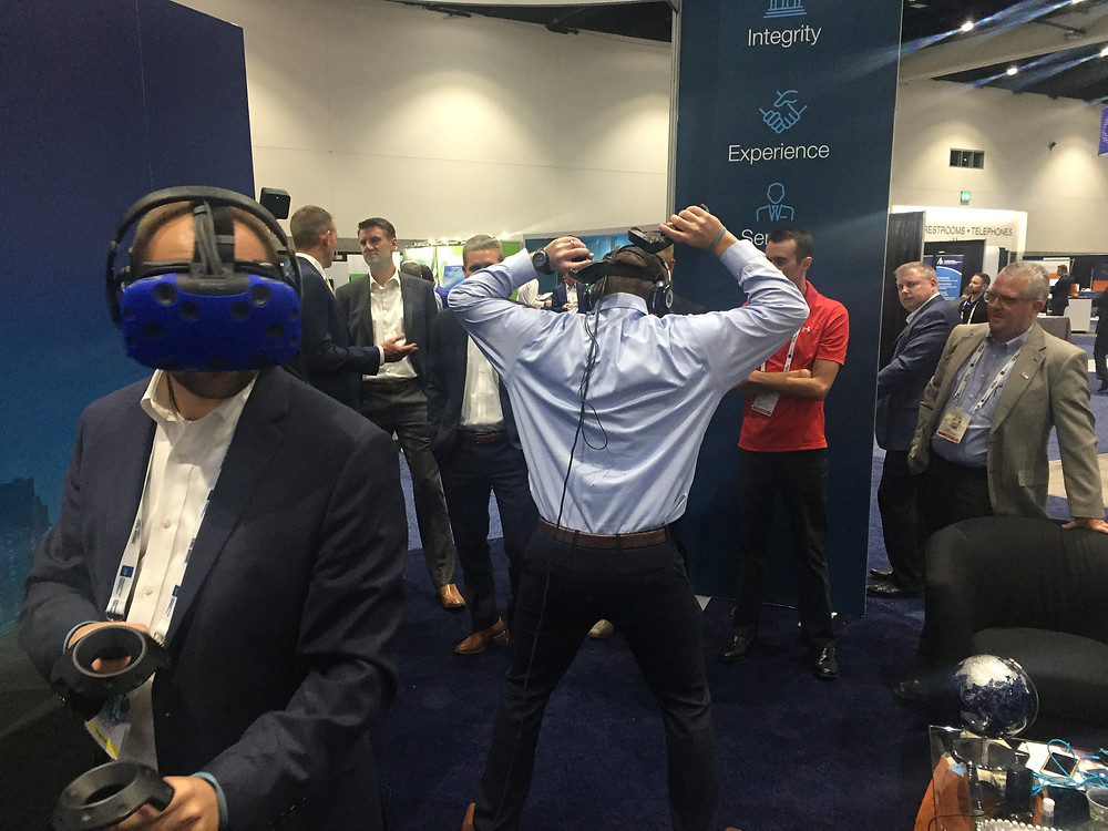 A trade show with multiple people wearing vr headsets