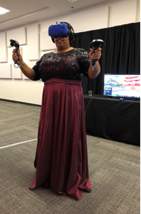 A Woman Dressed For An Event Is Trying A Virtual Reality Game