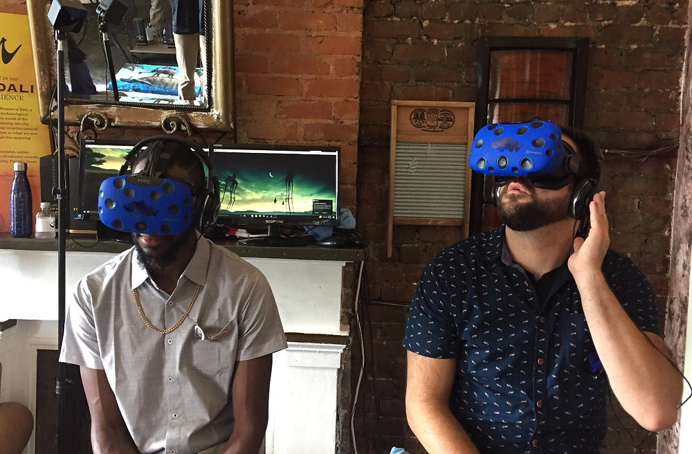 Two men wearing virtual reality headsets