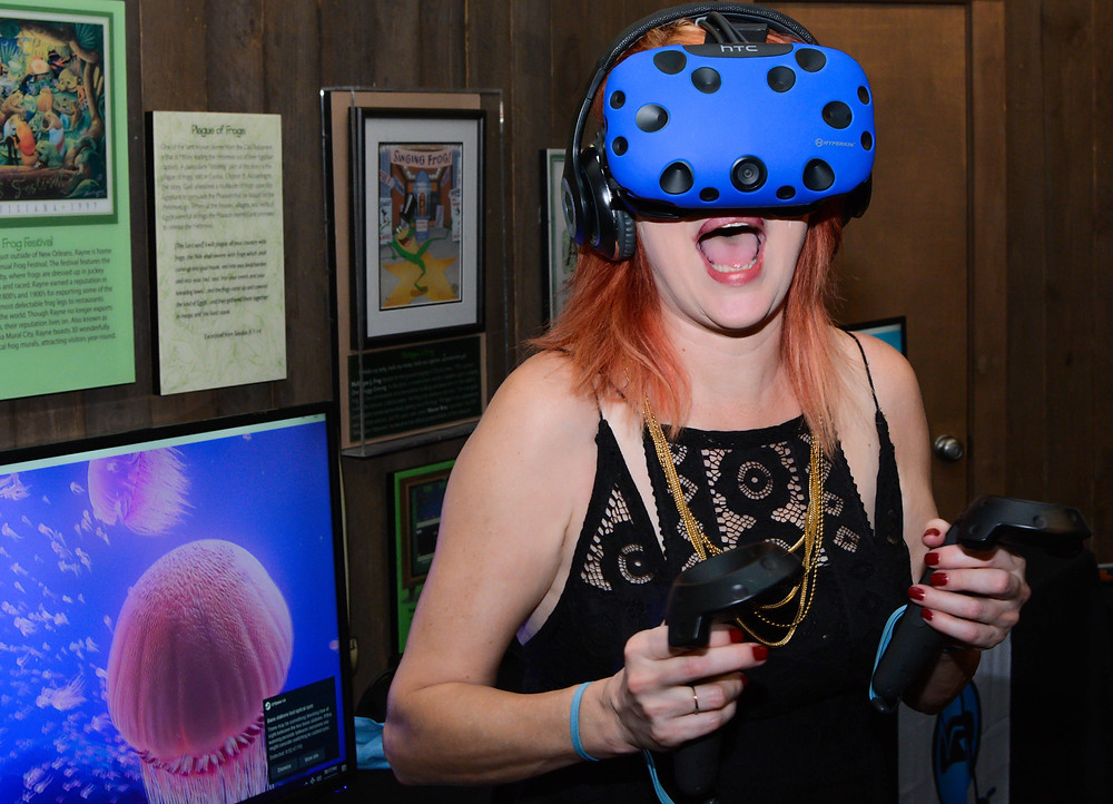 Woman wearing a virtual reality headset playing a vr game