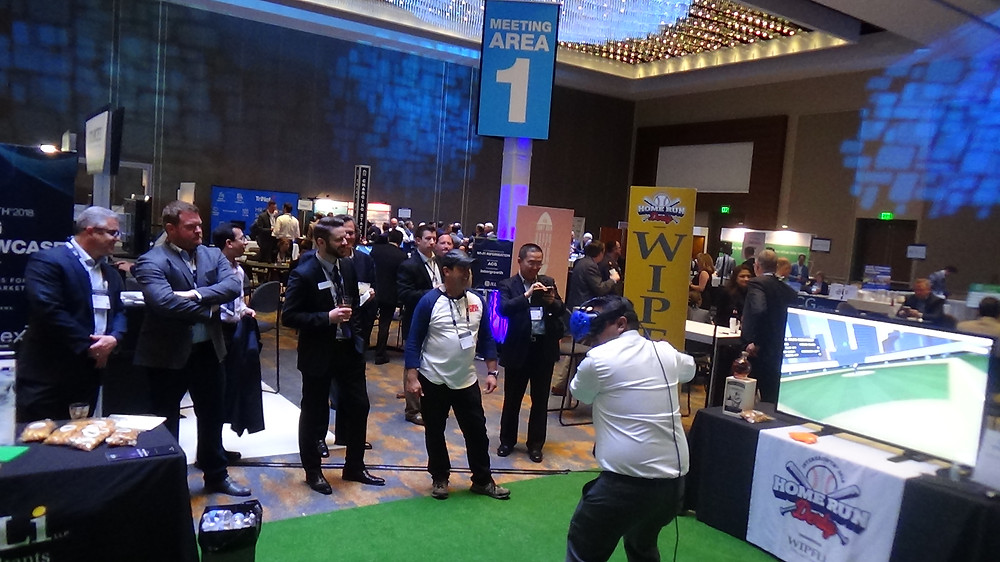 Crowded Virtual Reality (VR) Booth At A Corporate Event