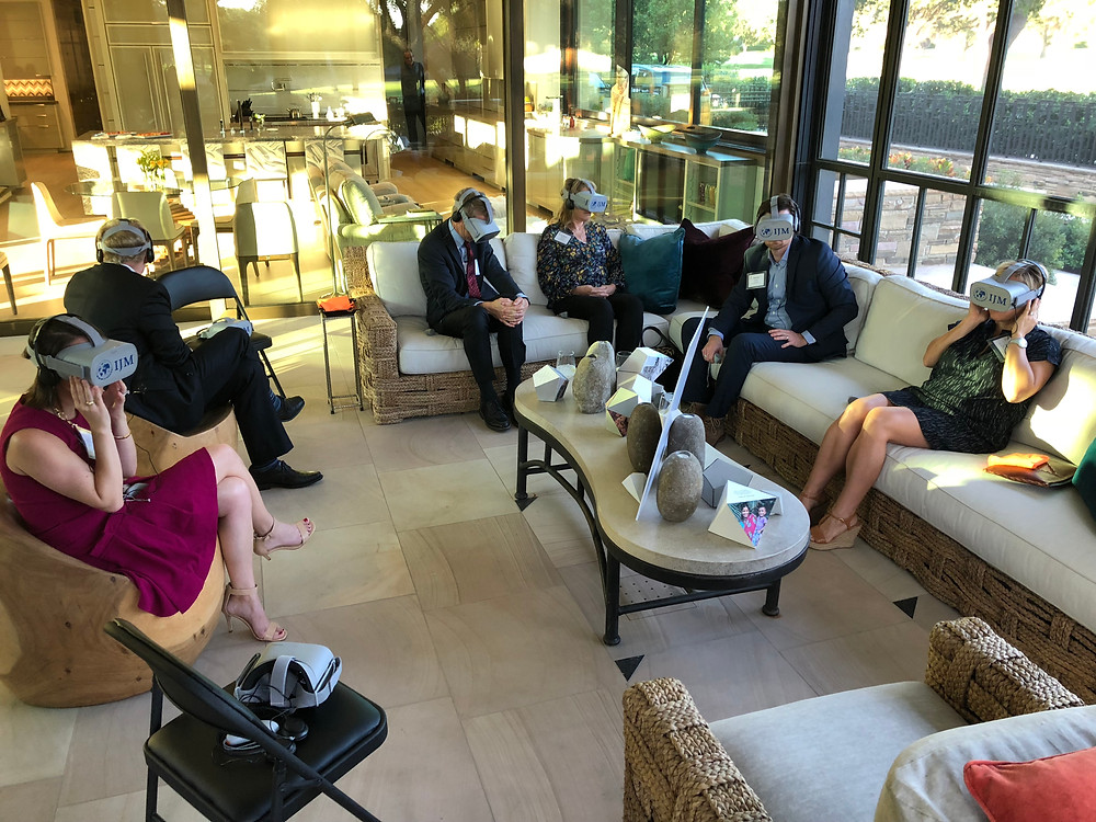 A Group Of People Hold A Business Meeting In Virtual Reality
