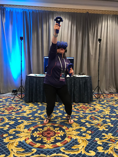 An Older Woman Moving As She Plays An Active Virtual Reality Game