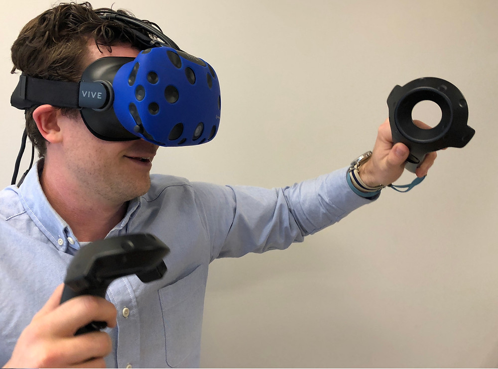 Man Trying HTC Vive Virtual Reality Headset
