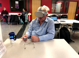 An Older Man Has A Meeting In Virtual Reality