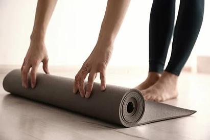 woman with yoga mat.webp