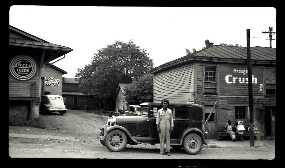Gentleman standing in front of his vehicle on Church Street