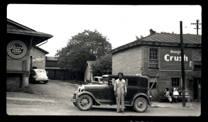 Gentleman standing in front of his vehicle on Church Street