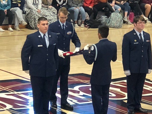 Kyle Ross, Nathan Sia, Tristan, and Dustin Bales participate in formal Flag Folding Ceremony.