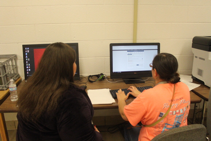 A Counselor helps a student's mom with FAFSA.