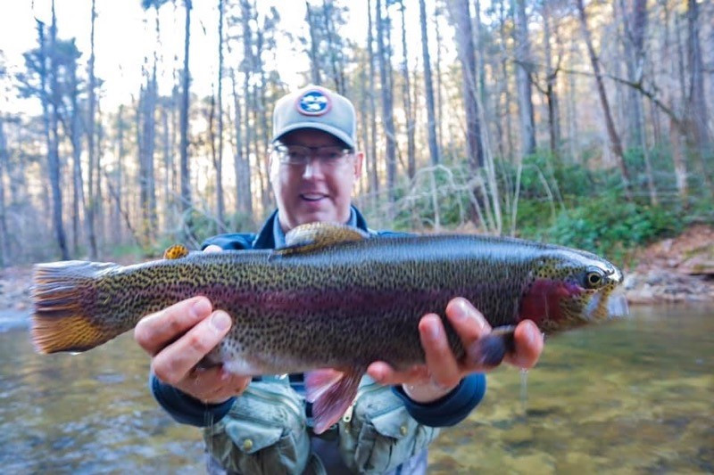 "Tim Landefeld, Assistant principal, catches rainbow trout at a local river and hopes to ""Fly Fish more in 2020."""
