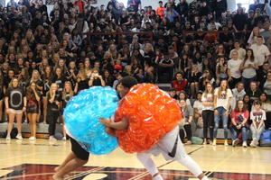 Sophomore and Junior class participants compete in sumo wrestling.