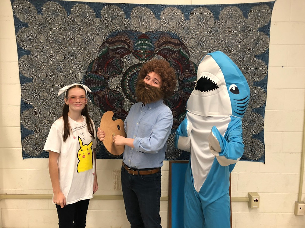 Hailey Galinat, Noah Metler, and Jesus Reyes wear their meme costumes on opening day of homecoming.