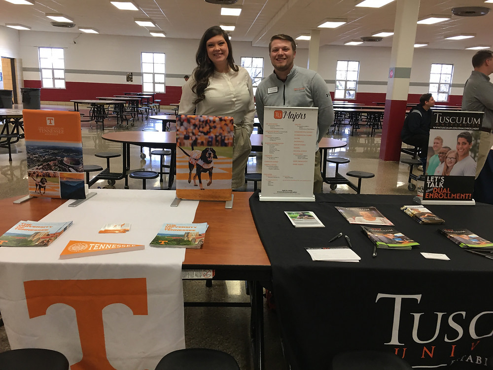 Representatives from UT and Tusculum University advertise their colleges to West students.