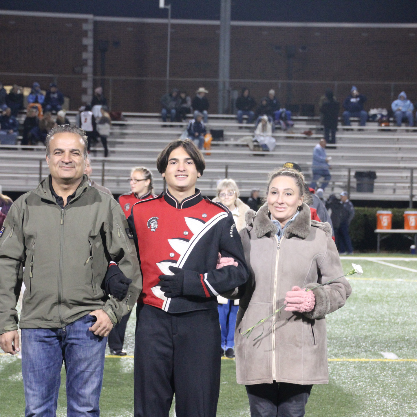 Demir Menguc escorted by Ismal Menguc and Beverly Menguc