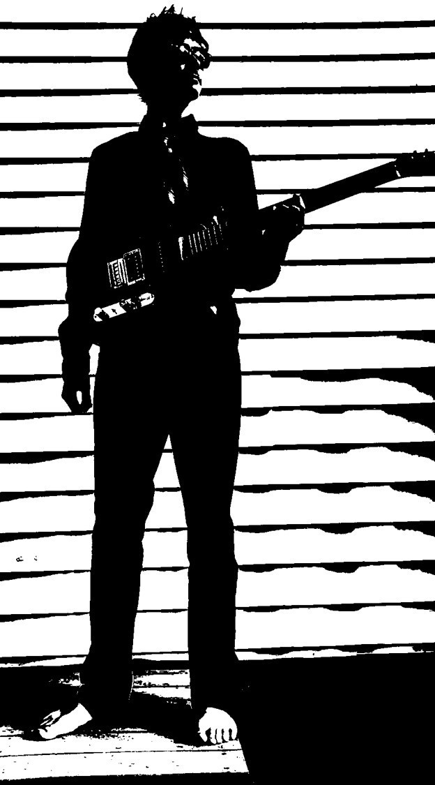 Man Posing with guitar