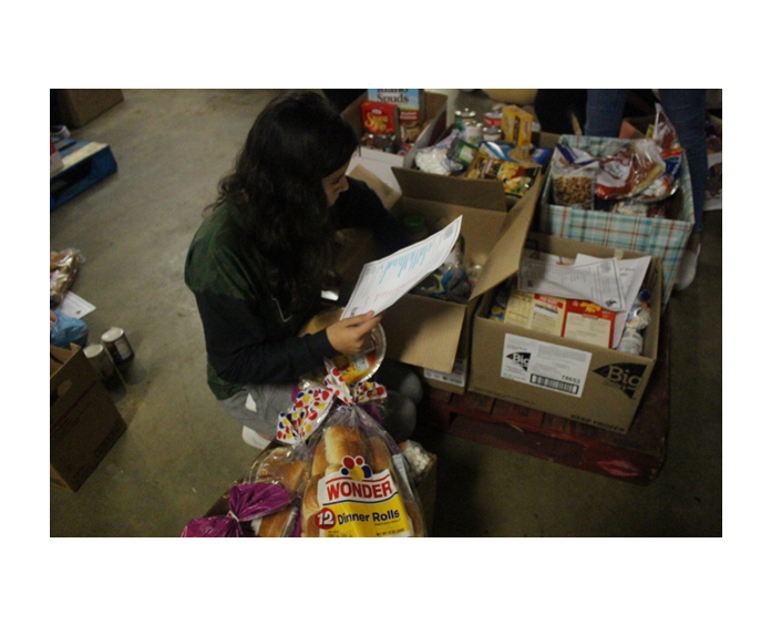 Eliana Alvarado sorts a Box at Central Services.