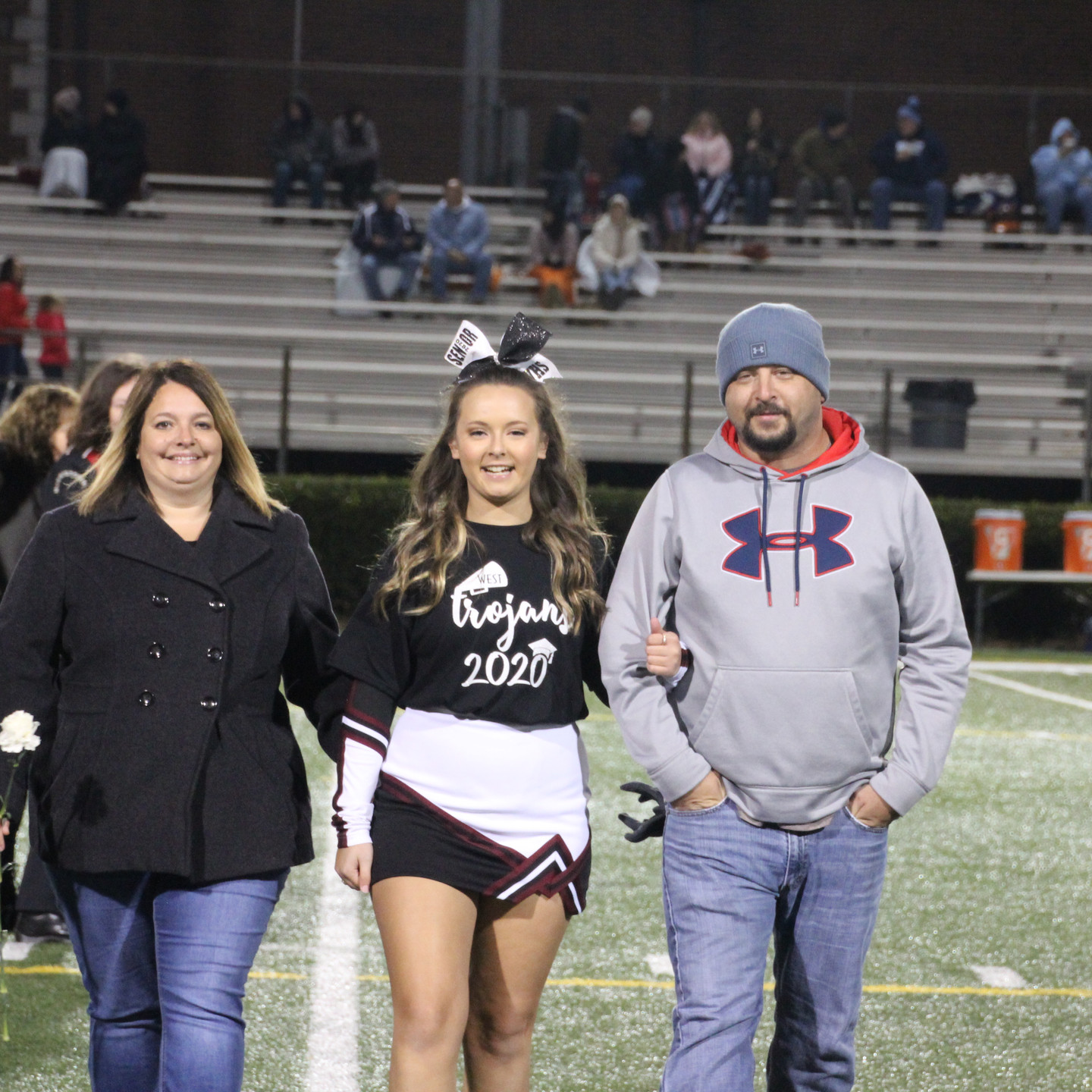 Scarlett Wampler escorted by Tara and Casey Wampler