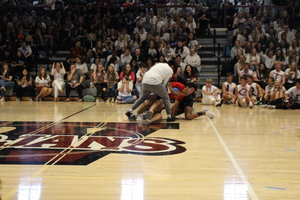 Students trying to go for the ball in the Helmet Hustle game.