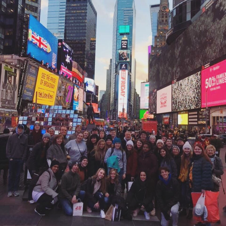 The choir stops for a group picture at Times Square, the place where the New Year ball drops every New Year. Photo from Shawn Salley, trip chaperone.