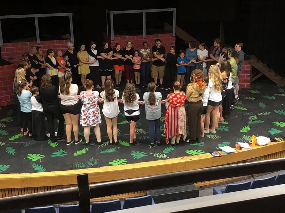 """The cast and crew of Madagascar Jr. in """"circle"""" before closing performance."""