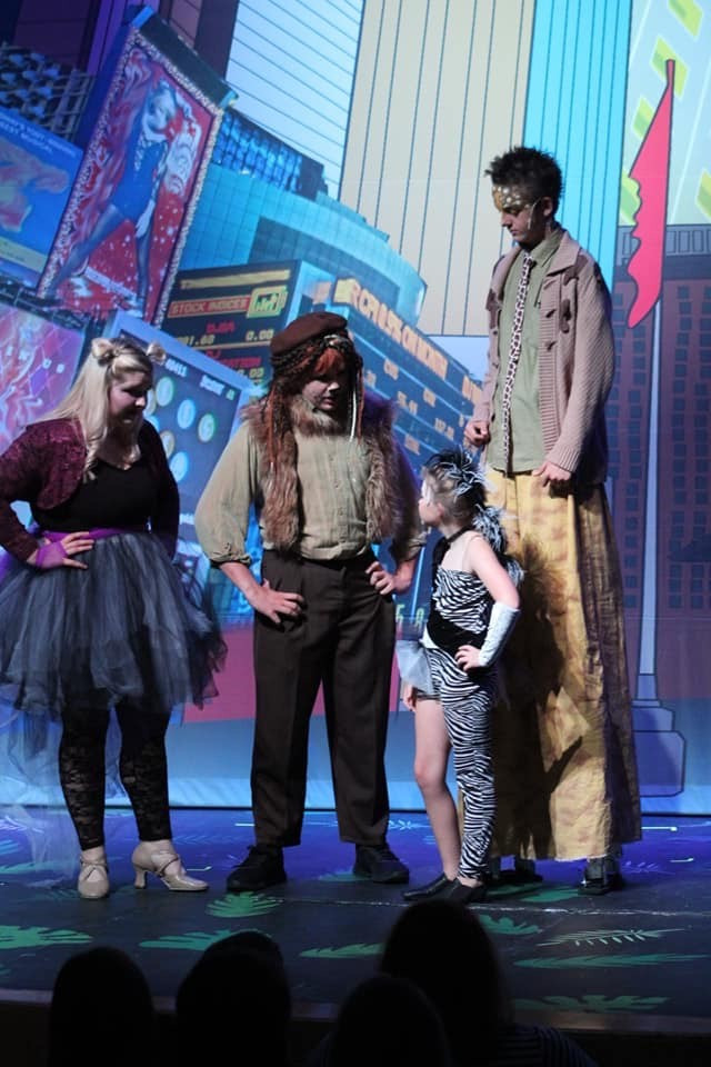 Madagascar Jr.'s four lead roles, played by London Keller, Sawyer Stacy, Jennie Marie, and Max Davis, mid performance.