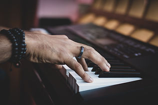 Man playing on a keyboard