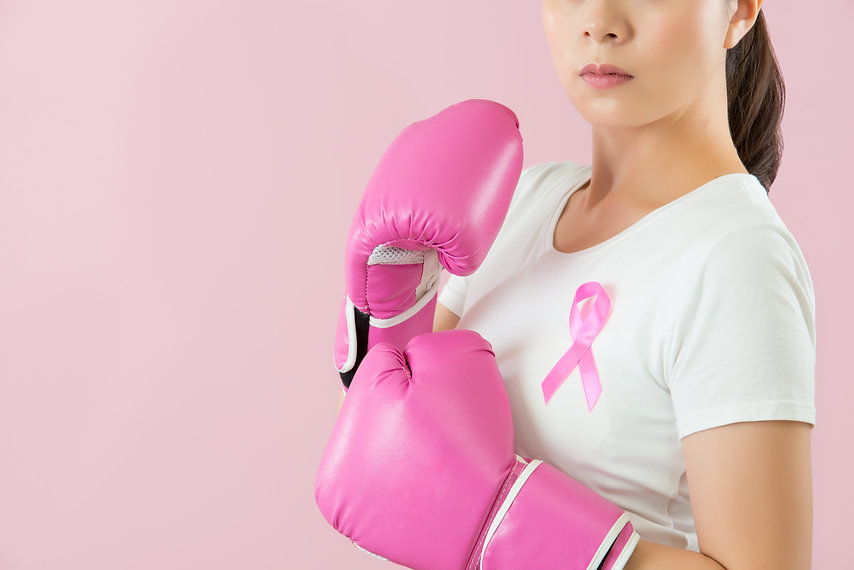 medical and health concept. angry woman fight showing pink boxing gloves fist punch out fo