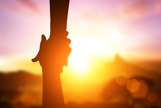 silhouette of  helpping hand  and hope c