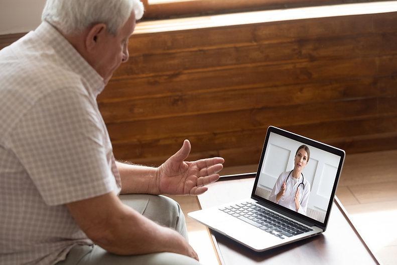 Focused older 80s male patient consultin