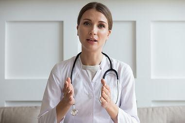 Head shot portrait woman doctor talking